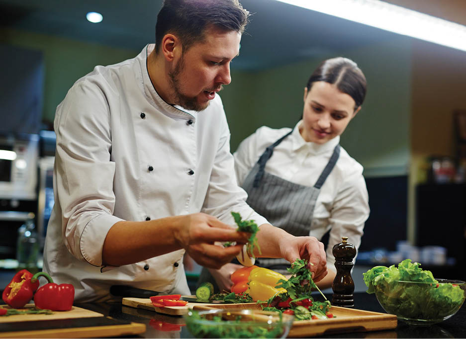 Culinary Art: Two chefs practicing the culinary arts